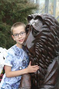 me hugging a sad lion